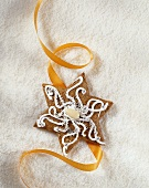 Gingerbread star, decorated in white and silver