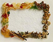 Frame of nuts, spices, fruits on grated coconut