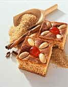 Two pieces of gingerbread, decorated with almonds & cherries