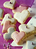 Hazelnut hearts with pastel-coloured icing
