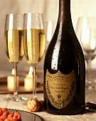 Bottle of Dom Perignon (1992), two glasses beside it