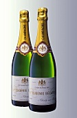 Two bottles of Veuve Eugenie Bezard champagne side by side