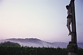 Crucifix in vineyard at sunrise, Bergheim, Alsace