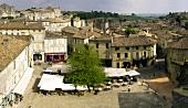Street café in main square of wine town of St Émilion, Bordeaux