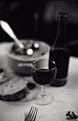 Red wine, glass in a 'Bouchon lyonnais' (simple bistro, Lyon)