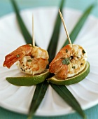 Shrimps with coriander marinade on lime slices