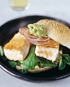 Salmon burger with guacamole and lettuce