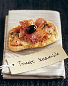 Cheese and tomatoes on toast with bacon and olive