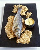 Sea bass on salt crust with lemon butter sauce