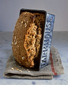 Wholewheat bread with oat flakes in loaf tin