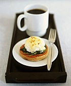 Egg Florentine (poached egg Florentine style); cup of coffee