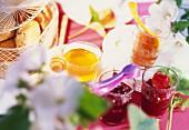 Three different jams, honey and breakfast rolls