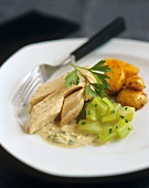 Poached salmon with wine sauce and cucumber salad