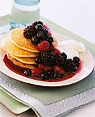 Pancakes with berry rumtopf and cream