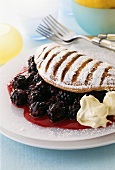Sweet souffle omelette with icing sugar and berry filling