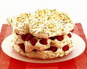 Raspberry and nut meringue gateau