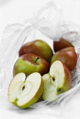Apples in an opened plastic bag