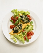 Polenta slices with spinach