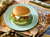 Fish and banana burger on plate; décor: picture, maps