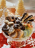 Lots of different Christmas biscuits in a glass bowl