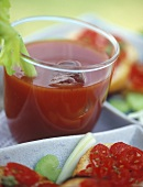 Bloody Mary in glass, garnished with stick of celery