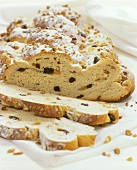 Christmas stollen with raisins and nuts, a piece cut