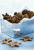 Gingerbread stars in and in front of a metal box