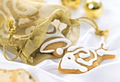 Christmas biscuits falling out of a gift bag
