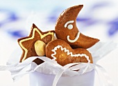 Chocolate gingerbread in a bowl; gift ribbon decoration