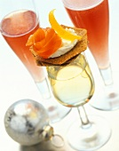 Canape on glass of dry sherry, Pink Cava cocktail behind
