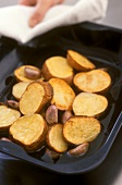 Baked sweet potato slices with garlic