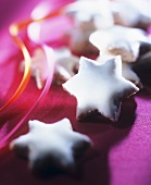 Cinnamon stars on violet background