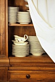 Crockery in kitchen cupboard