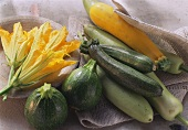 Various varieties of courgettes and courgette flowers