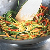Frying vegetables in wok (stir-frying)