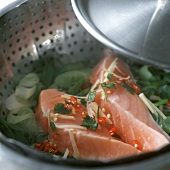 Steaming tuna & vegetables in steaming pan with strainer insert