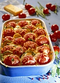 Courgette and potato bake with whole unpeeled tomatoes