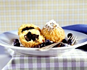 Poppy seed dumplings with marinated blueberries