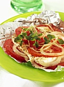 Tomatoes with sheep's cheese baked in foil