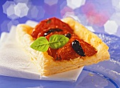 Puff pastry slices with tomatoes and olives