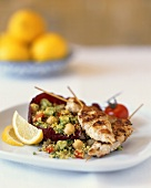 Fried chicken kebabs with couscous & vegetable salad