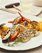 Barbecued chicken breast with herb butter and vegetables