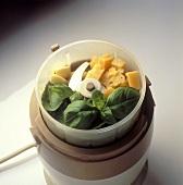 Pesto ingredients (basil, Parmesan, garlic) in blender