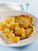 Sweet pumpkin and potato biscuits with fruit kebabs