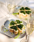 Open cheese & chive sandwiches arranged like 4-leaf clover