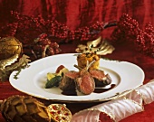 Saddle of lamb with vegetables & tomatoes on Christmas plate