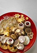 Colourful plate with assorted biscuits and stollen