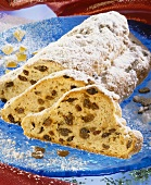 Christmas stollen packed with raisins, a piece cut
