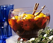 Christmas punch with whole oranges in glass bowl