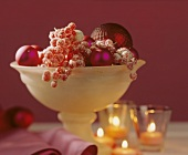 Glass bowl of berries & Christmas baubles as table centre